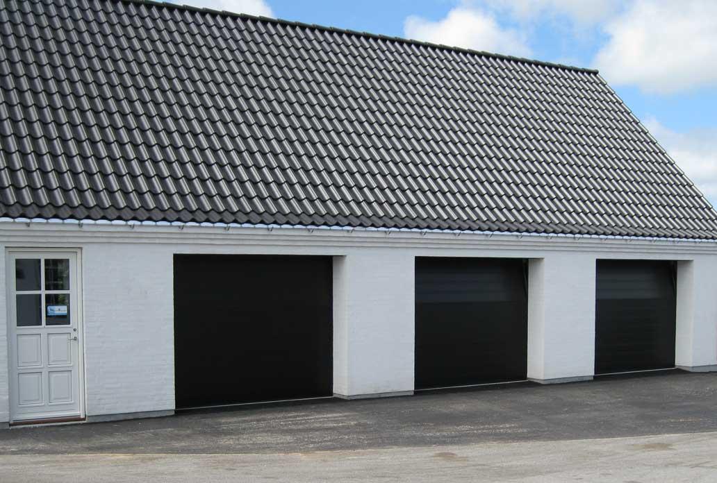 Nassau classic black garage door white house