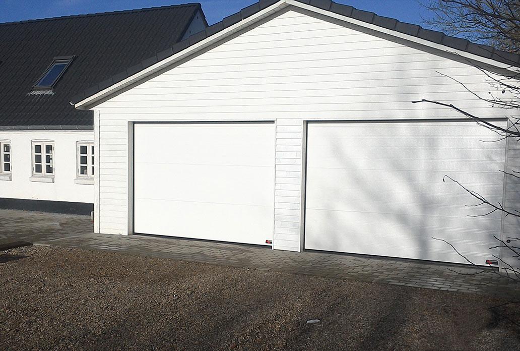 White NASSAU garage doors with no windows or doors