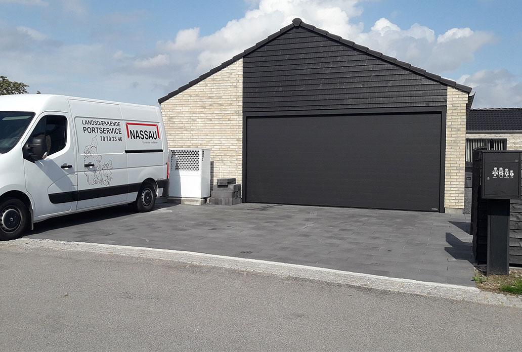 wide black granite garage door with no windows
