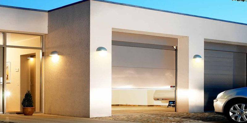 Grey classic garage door with lights around it